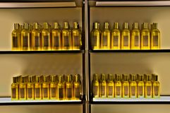 Golden bottles in a row on a shelf. royalty free stock image