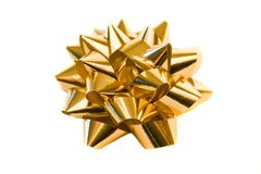 Golden bow. Single shiny golden bow, isolated over white Stock Images