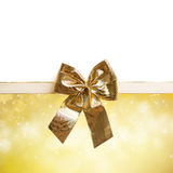 Golden bow on festive background Stock Photography