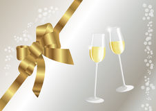 Golden bow and glasses with sparkling wine. Two glasses with sparkling wine and grey background Royalty Free Stock Photography