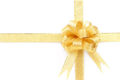 Golden bow with golden ribbon Royalty Free Stock Photography