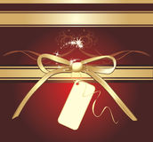 Golden bow with holiday card. Holiday background Stock Photography