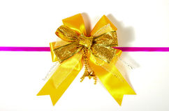 Golden bow isolated on white Royalty Free Stock Image
