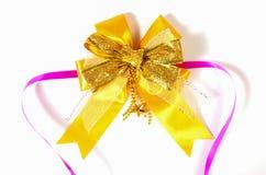 Golden bow isolated on white Stock Photos