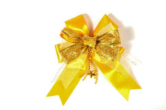 Golden bow isolated on white Royalty Free Stock Photo