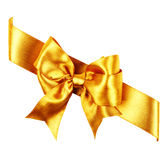Golden bow made from silk Stock Photo
