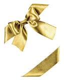Golden bow made from silk ribbon Stock Photo