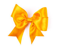 Golden bow made from silk ribbon Royalty Free Stock Photography
