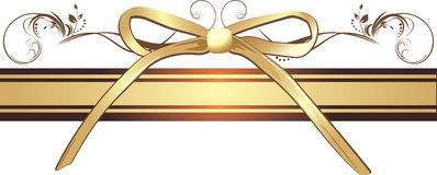 Golden bow with ornament on the decorative ribbon Stock Image