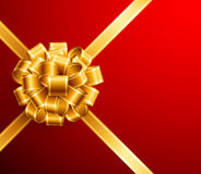 Golden bow on red background Stock Photo