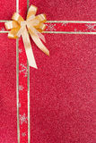 Golden bow and red ribbon Royalty Free Stock Photos