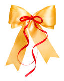 Golden bow with red ribbon made from silk Stock Photography