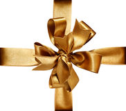Golden Bow & Ribbon. Gift golden ribbon and bow isolated on white. The file includs clipping path Royalty Free Stock Photo