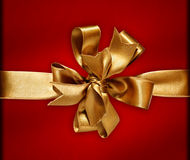 Golden Bow & Ribbon. Gift golden ribbon and bow isolated on white. The file includes clipping path Stock Photography
