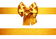 Golden bow and ribbon from silk Stock Photography