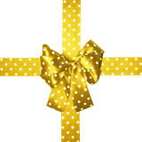 Golden bow and ribbon with white polka dots made from silk Stock Photography