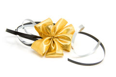Golden bow with streamers Stock Image