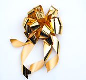 Golden bow on white background Royalty Free Stock Photography