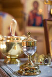 Golden Bowl for communion in the Church Stock Photo