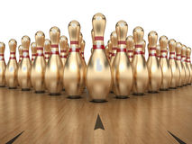 Golden Bowling Pins Stock Image