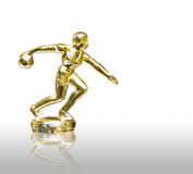 Golden bowling player statue isolated. On white background stock photo