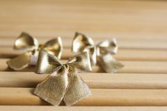 Golden bows tied Christmas decoration Stock Image