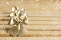 Golden bows tied with effect Royalty Free Stock Photography