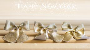 Golden bows tied with text effect Stock Photos