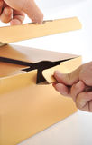 Golden box. Man Opening the golden box Stock Images