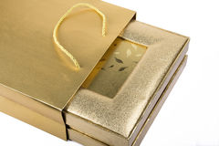Golden box and bag Stock Images