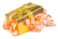 Golden box with bow and pink ribbons Stock Photos