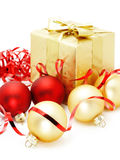 Golden box with christmas baubles Stock Photos