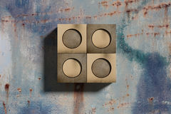 Golden box with circles on grunge wall stock illustration