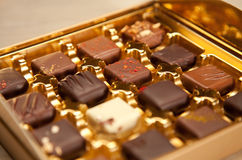 Golden Box of Square Shaped Chocolates Royalty Free Stock Photography