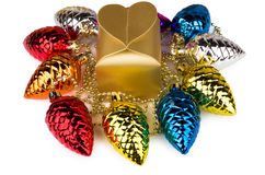 Golden box and toys in form of fir cones Stock Photo