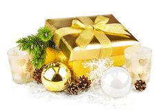 Golden box with twig Christmas tree and decoration. Golden box with twig Christmas tree inside and decoration isolated on white background Royalty Free Stock Photo