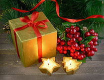 Golden box with two candles and ilex Stock Images