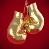 Golden boxing gloves hang render Stock Photos