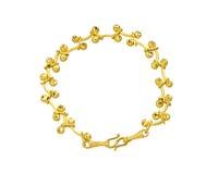 Golden bracelet isolated on white. Nice unique design of golden bracelet isolated top view on white background Royalty Free Stock Photo