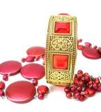 Golden bracelet with beads Stock Photos
