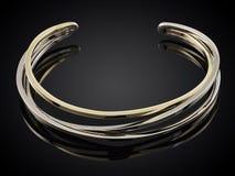 Golden bracelet  on black Stock Photos