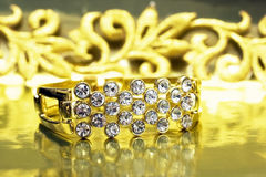 Golden bracelet with brilliants Royalty Free Stock Photos