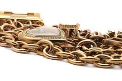 Golden bracelet with heart shape Stock Photography