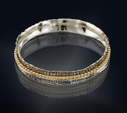 Golden bracelet isolated on black Stock Photos