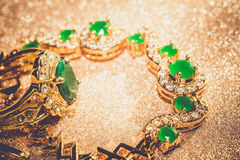 Golden Bracelet With Emerald Filtered Royalty Free Stock Image