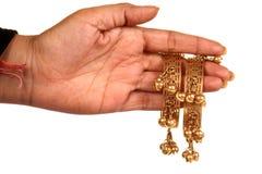 Golden bracelets stock photos