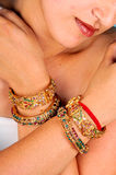 Golden bracelets and bangles Stock Photos