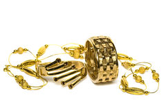 Golden bracelets with beads Stock Images