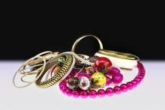 Golden bracelets and beads stock photo
