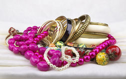 Golden bracelets and beads royalty free stock images